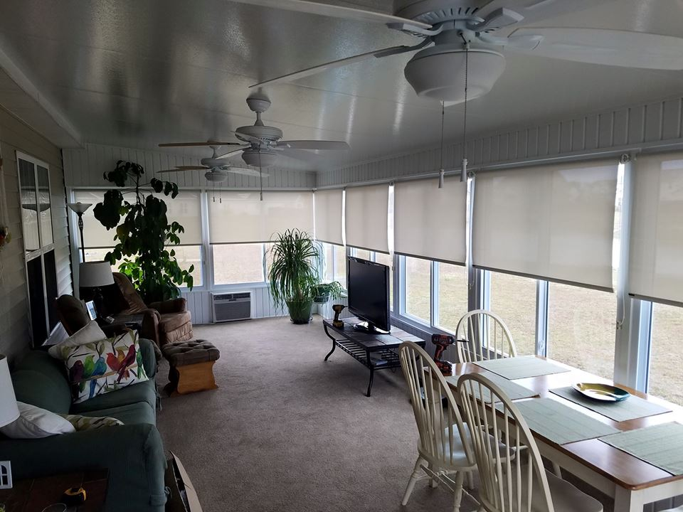 Installed roller shades to sun room